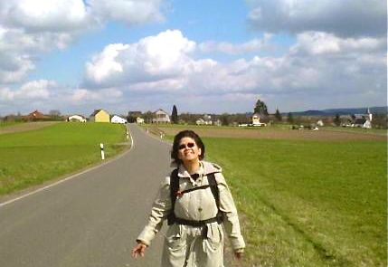 """Mrs Easy Hiker along a road in Karl Germany"""