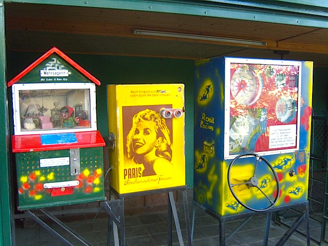 """Vintage games machines among them a peep show machine"""