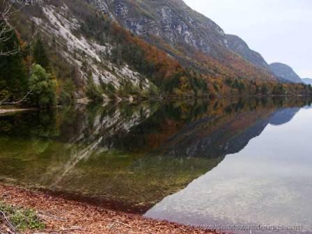 """Lake reflection seen when hiking In Slovenia on an easy hike"""