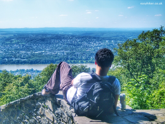 """Relaxing in front of a panoramic view from the top of a Rheinsteig hiking trail in Germany"""