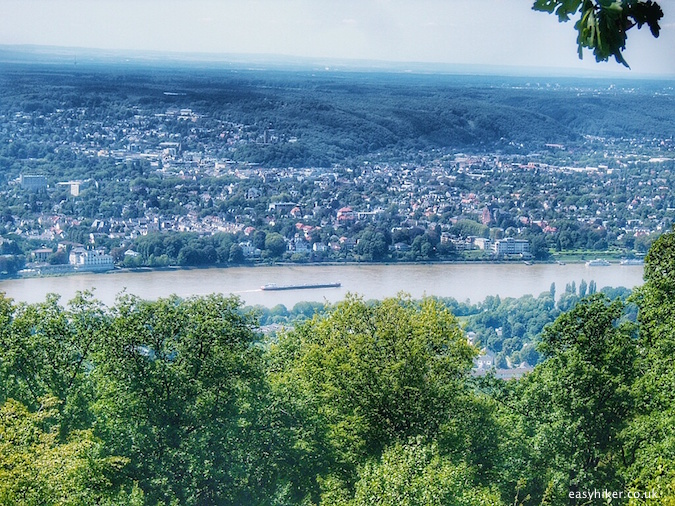"""A boat on the Rhine seen from the top of a Rheinsteig hiking trail in Germany"""
