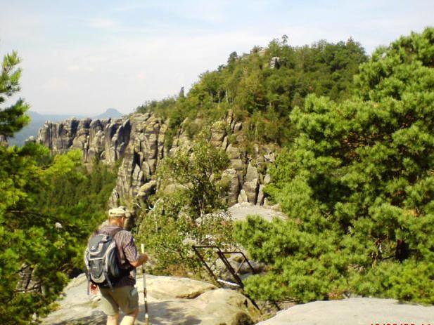 """Hiker along the Malerweg hiking trail in Germany"""