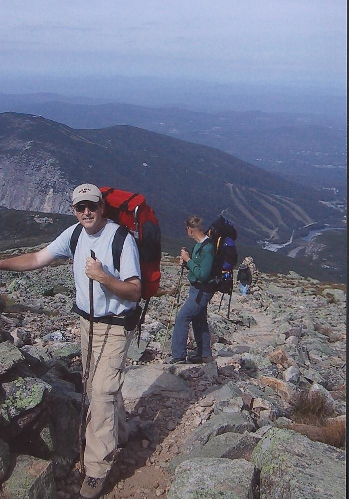 """Hikers guiding themselves from cairn to cairn in Bob Muir Ridge"""