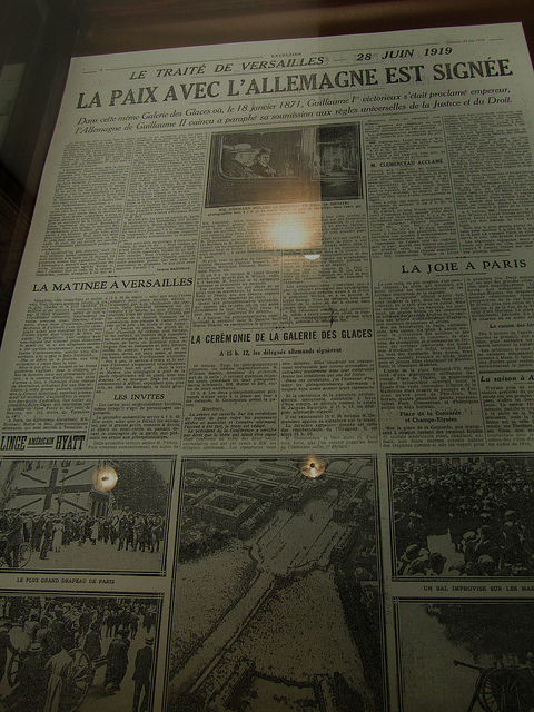 """A French newspaper front page clipping headlining the signing of the Peace Treaty in 1919 between France and Germany"""