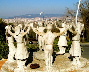 """Figures representing dancers performing traditiona Catalan dance on Barcelona Montjuic park"""