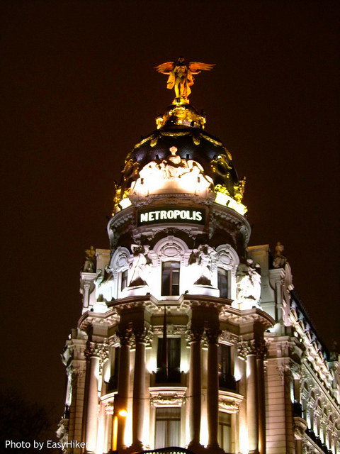 """Metropolis seen on midnight in Madrid Spain"""