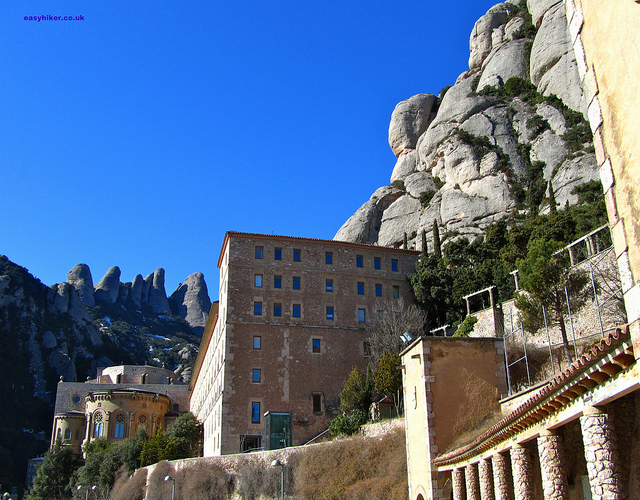 """The Monastery of Montserrat among surround by the rocks of the mountain"""