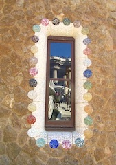 """Parc Guell in Barcelona reflected in a window in the park"""