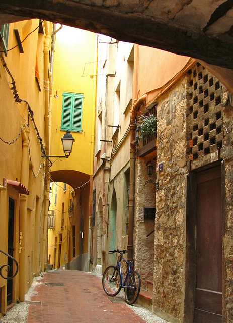 """A typical narrow medieval street alley in Menton France"""