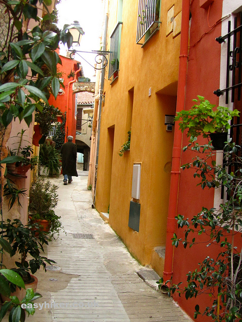 """Typical narrow medieval alley street in Menton in the South of France"""