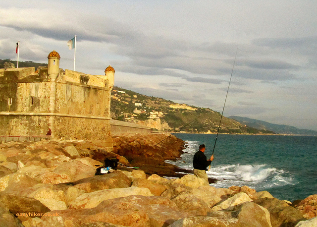 """Fishing along the coastline of Menton France"""