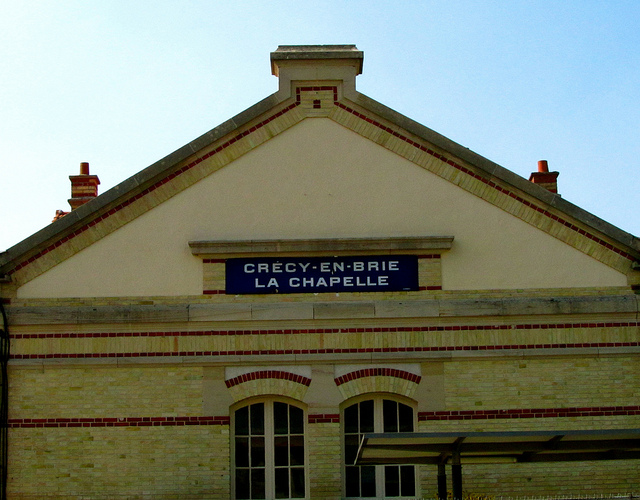 """A place in a Parisian banlieue Crecy La Chapelle main train station"""