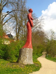 """Statue of a woman hewn from a tree trunk in Schwerin Germany"""