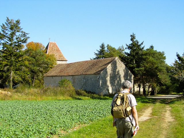"""Easy Hiker Approaching the Châteaupers farm"""