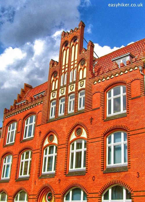 """An old restored house showing the bricks in buildings in Wismar Germany"""