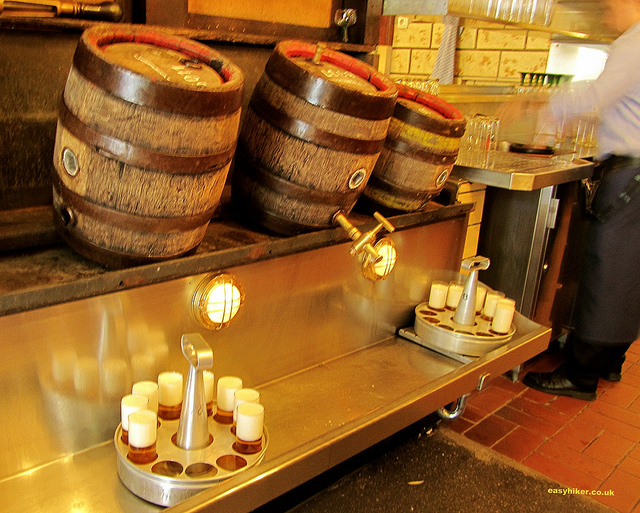 """Small barrels of beer on the counter at the German culinary institution of Päffgen Brewery in Cologne Germany"""