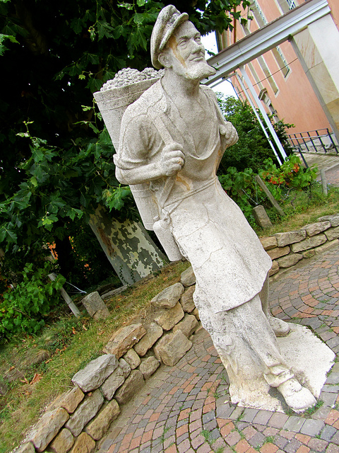 """the harvest worker immortalised and honoured with a statue in the town with the largest wine barrel"""