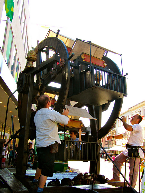"""a hand turned mini ferris wheel for children in a wine festival in Speyer Germany"""