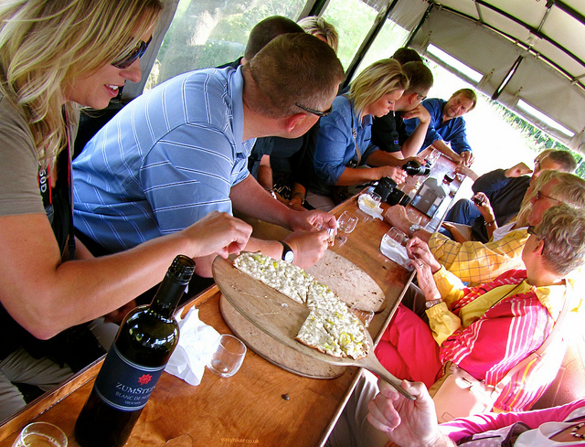 """Guests participating in a vineyard tour sharing a passion for all that is wine"""