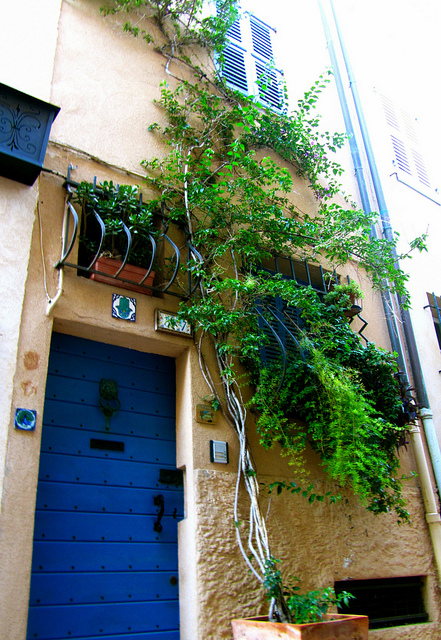 """A colourful doorway seen in a back alley of Antibes"""