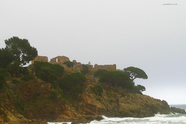 """""""A castle ruin seen from the beach of La Fosca in Costa Brava"""""""