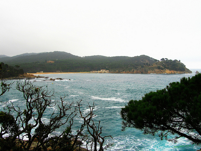"""A scenic view from the Cami de Ronda along the picture pretty trail of La Fosca seen through a frame"""