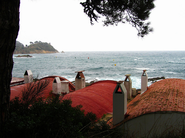 """The roofs of small concrete buildings in the fishing village along the Cami de Ronda"""