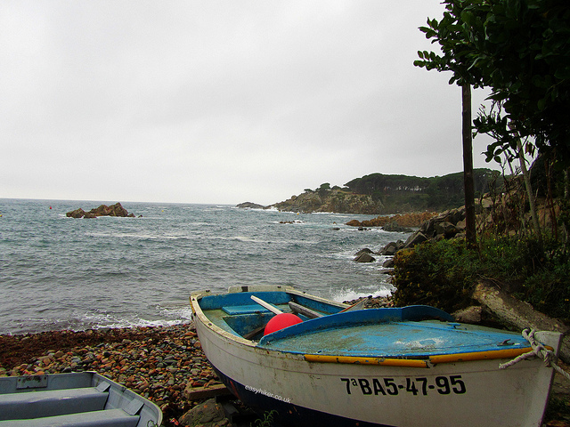 """A boat on the beach  along the Cami de Ronda"""