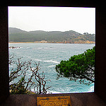 """A scenic view of the La Fosca trail along the Cami de Ronda seen through a picture frame"""