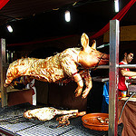 """Whole roasted pig on a spit"""