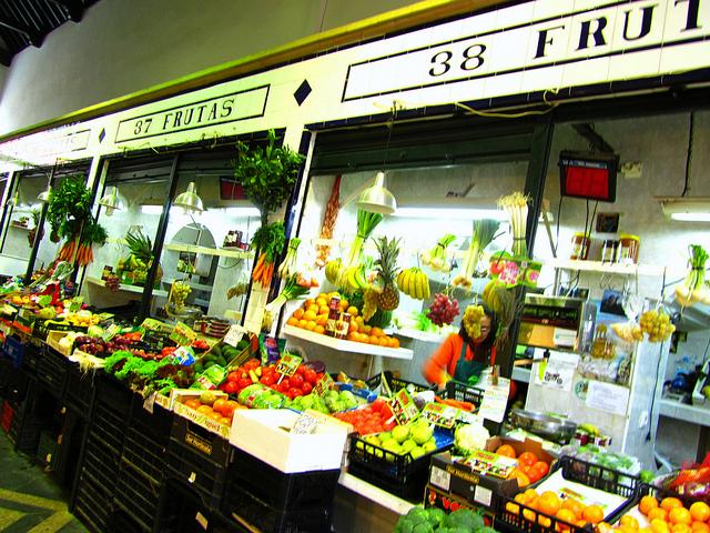 """Fruit stalls inside the Mercado de Feria to go to market in Seville"""
