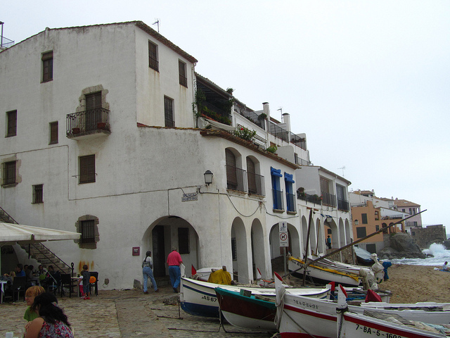 """Boats parked by the beach of the old fishing village of Calella de Palafrugell"""