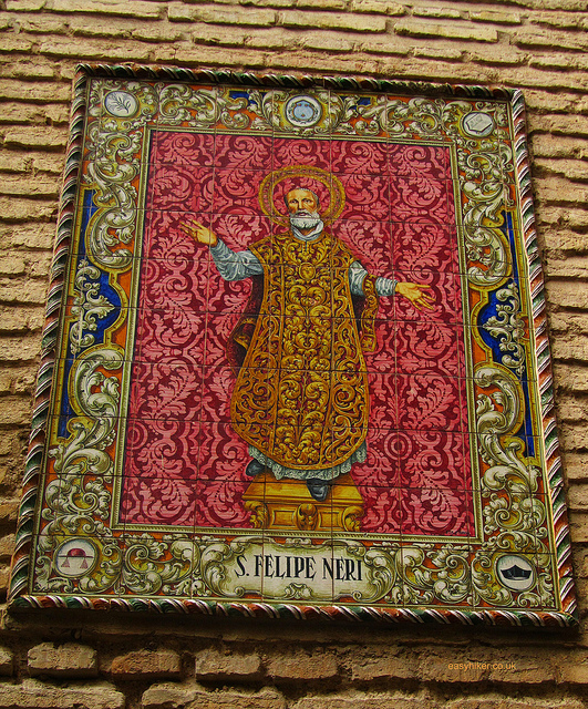 """Image of a saine depicted with tiles of Seville on a church wall"""