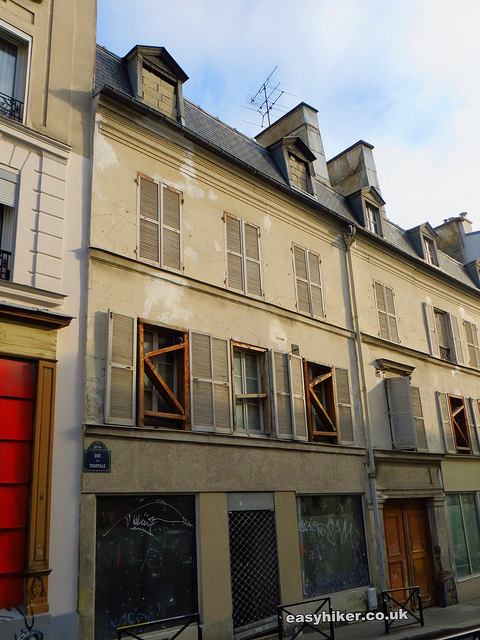 """A derelict building being renovated  seen on a Paris urban walk in the Belleville of Edith Piaf in Paris"""
