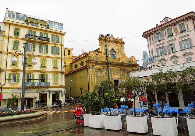 """Restaurants and office buildings in the town square of San Remo Italy"""