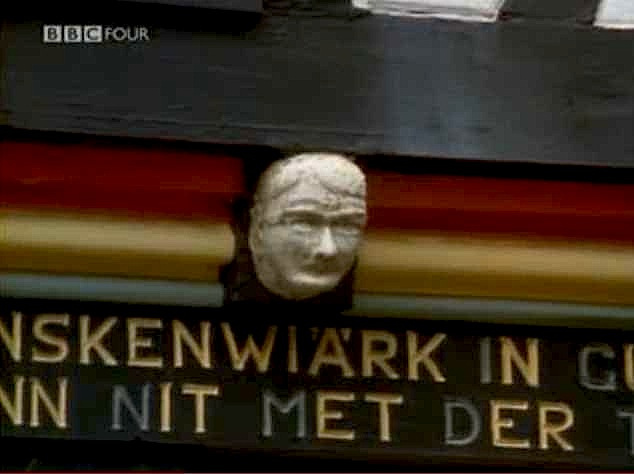 """Head mask of Hitler on the facade of Ottenshof restaurant in Germany"""