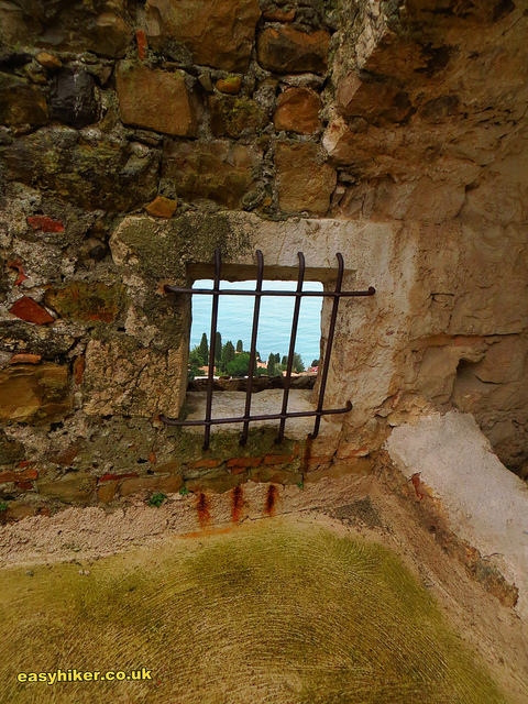 """sea view through a grill from the Roquebrune Castle"""