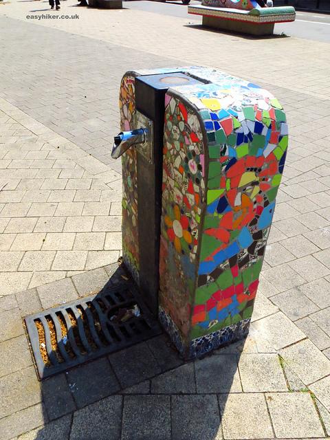 """Walks near Paris - Tiled water faucet in a Paris suburban small park"""