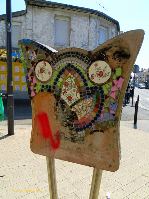 """Walks near Paris - Vandalised tiled notice board in a Parisian suburb"