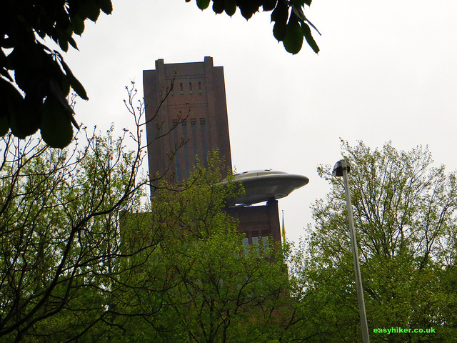 """a view of a flying saucer on a pleasant urban promenade in Utrecht"""