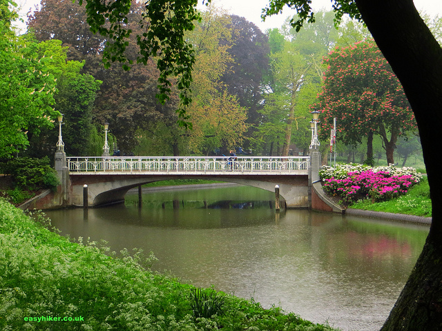 """bridge over the canal along a pleasant urban promenade in Utrecht"""