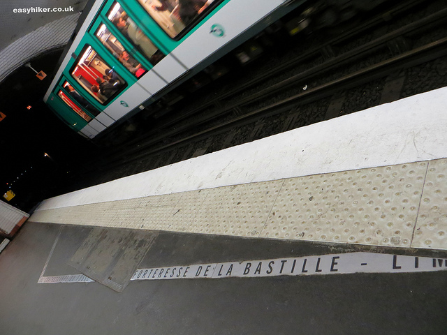 """marks of where old Paris walls on a quay in Bastille metro station along themed walks in Paris"""