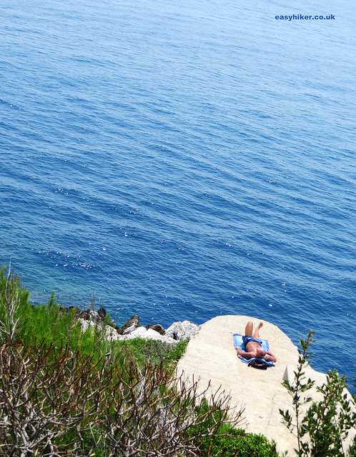 """sunbather on one of the many free places along the Cap Martin coastline"""