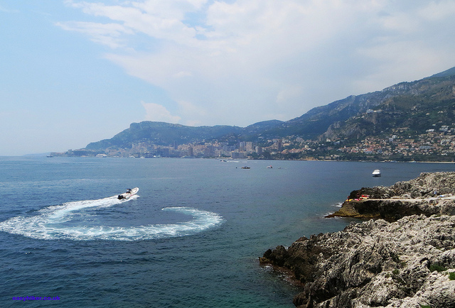 """speed boat circling towards Monaco in a Cap Martin cove"""