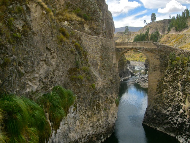 """Hiking in Peru - A stone bridge crossing the Colca Canyon"""