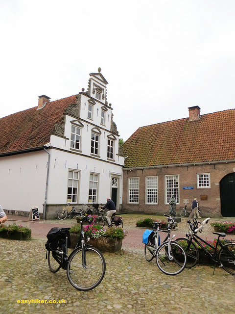 """Charming old buildings and modern bikes seen when hiking in Holland"""
