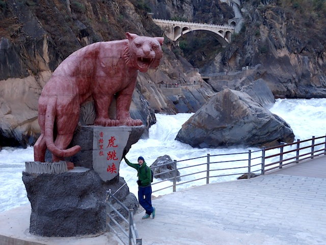 """Jonny Blair at the Tiger statue before going hiking Tiger Leaping Gorge"""