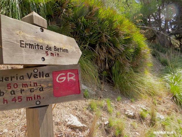 """Sign pointing to the hiking trail to Ermita de Betlem in Mallorca beyond the beaches"""