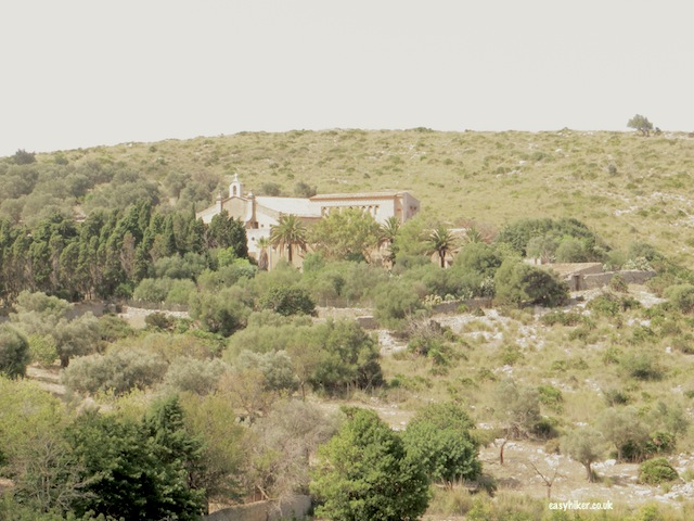 """View of church of the Ermitage along the Ermita de Betlem trail when hiking in Mallorca"""
