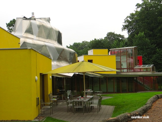"""The Ronald McDonald Gehry House of Oeynhausen and it's barbecue area by the back garden."""